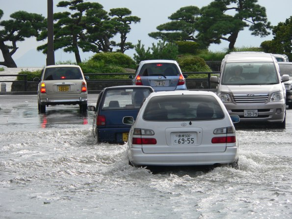 stockvault-cars-driving-on-a-flooded-street-in-matsue-japan235276.jpg